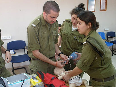 Sgt. Gilad Nesher began delivering the baby of Palestinian woman from the Jordan Valley
