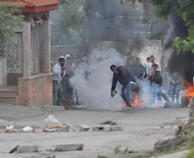 Rioter Hurls Firebomb in El-Arrub