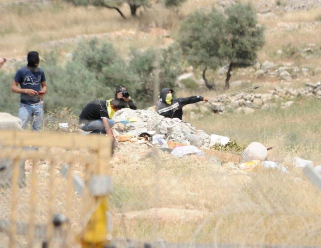 Palestinian Rioter Hurling Rocks in Bil'in