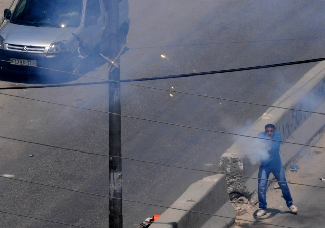 Qalandiya Rioter Shoots Firecracker