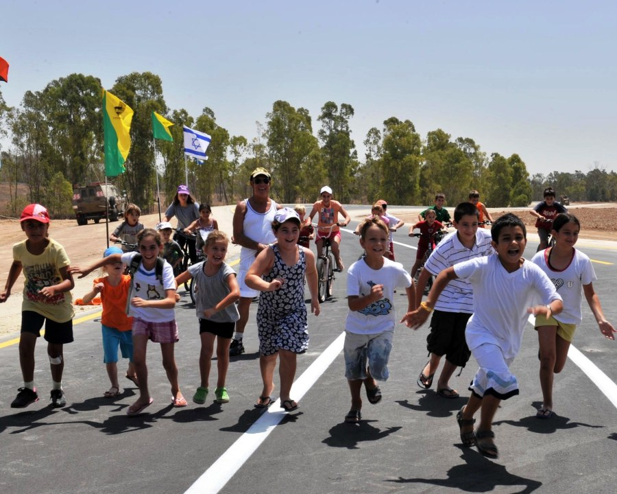 Israeli children running on road