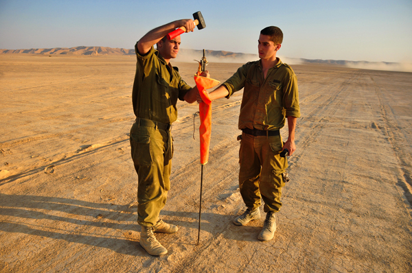 Sodiers of the Frontal Landing Unit marking the runway, IAF, Israeli Air Force