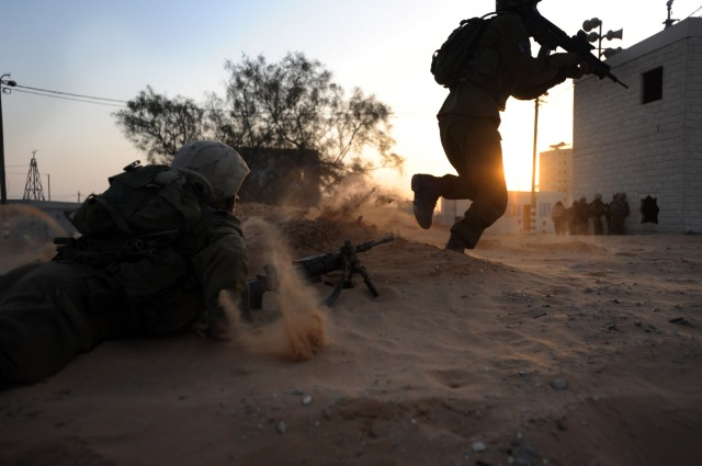Covered by his fellow soldier, a soldier charges the target, IDF, Gaza, Hamas